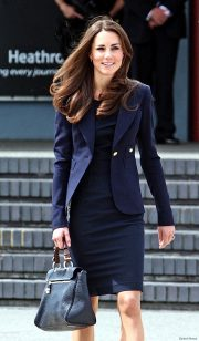Kate Middleton wearing the blue Smythe jacket at Heathrow Airport ahead of the Canada 2011 tour