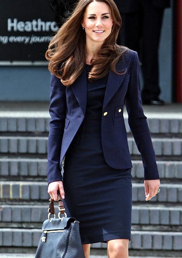 Kate wears Smythe and Roland Mouret at Heathrow Airport