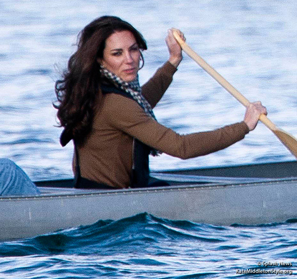 Kate paddles a canoe in a Zara shirt and Aquascutum Scarf