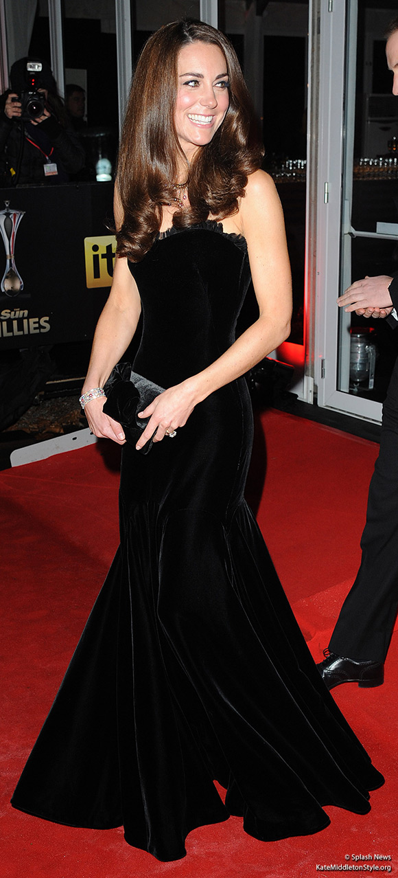 "The Duchess of Cambridge attends the ""Millies"" wearing a black velvet Alexander McQueen dress"