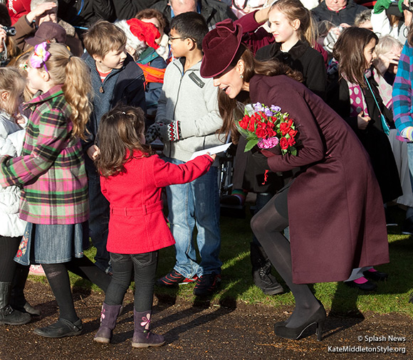 The Duchess of Cambridge wears an aubergine coloured dress