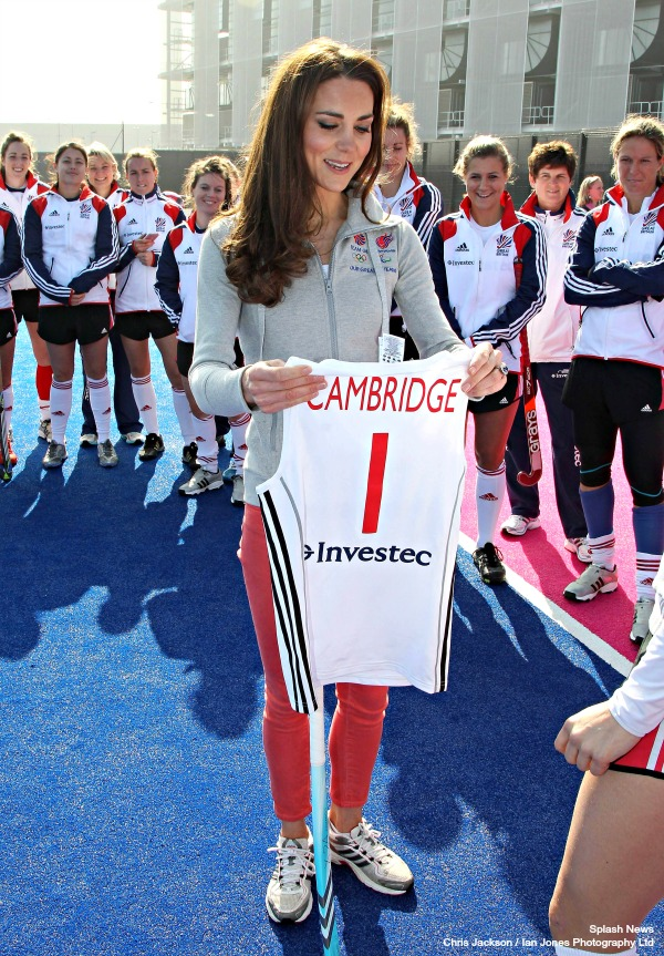 LONDON, ENGLAND - MARCH 15: ROTA: Catherine, Duchess of Cambridge smiles as she wears the Team GB Official Supporter's Scarf for London 2012 before meeting the GB HockeyTeam at the Riverside Arena in the Olympic Park on March 15, 2012 in London, England. The Duchess of Cambridge viewed the Olympic park as well as meeting members of the men's and women's GB Hockey teams. Photo by Chris Jackson - supplied by Ian Jones Photography Ltd.