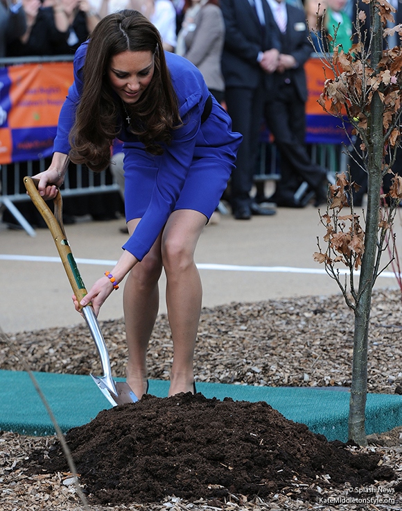 Kate plants a tree at EACH's Treehouse hospice.