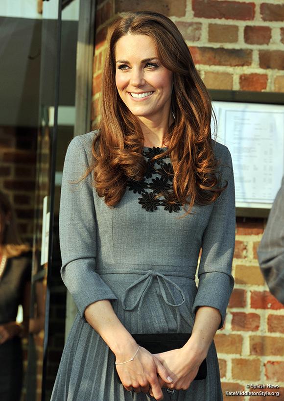 Duchess Kate wore an Orla Kiely dress, a Tiffany bracelet, carried a mystery clutch bag.