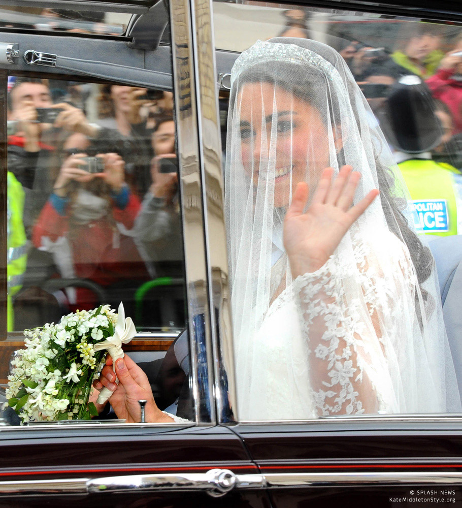 Kate's veil is down as she travels by car to her wedding