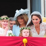 Kate on the balcony with her mum and bridesmaids