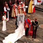 Kate's father lifts her wedding veil in the Abbey