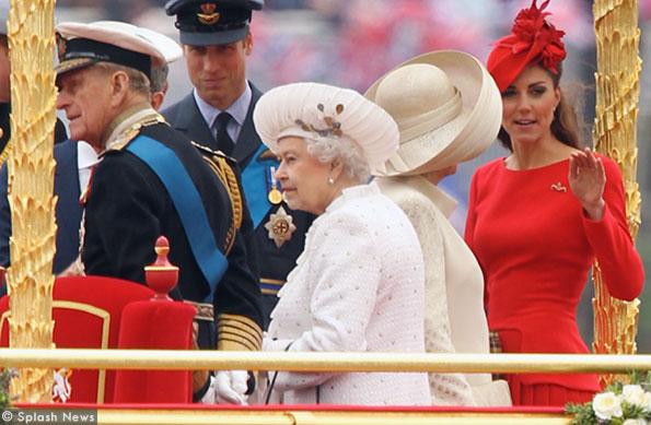 kate wears a red McQueen dress