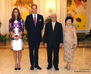 Day One:  Kate wears purple and white print dress by locally-born designer Prabal Gurung for State Dinner