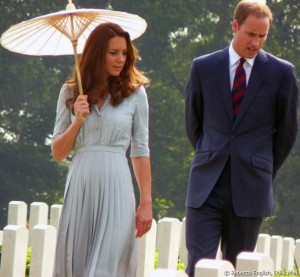 Kate holds a parasol while touring the graves at Kranji war cemetery
