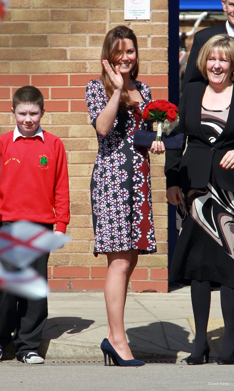 Pregnant Kate Middleton visits Manchester in 2013. The Duchess wears an Erdem dress