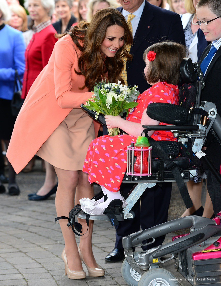 Kate Middleton visiting Naomi House Hospice wearing peach in 2013