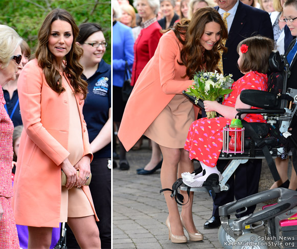 kate visits hospice wearing peach/coral colour outfit