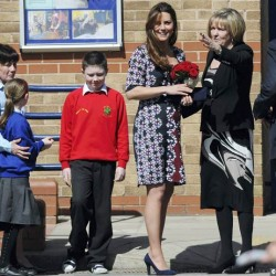 Duchess wears red & blue Erdem floral dress at Manchester school today