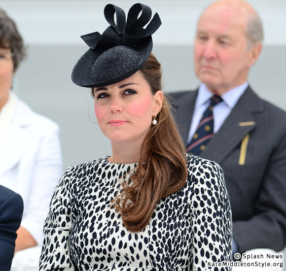 kate wears a dalmatian/leopard print coat to event