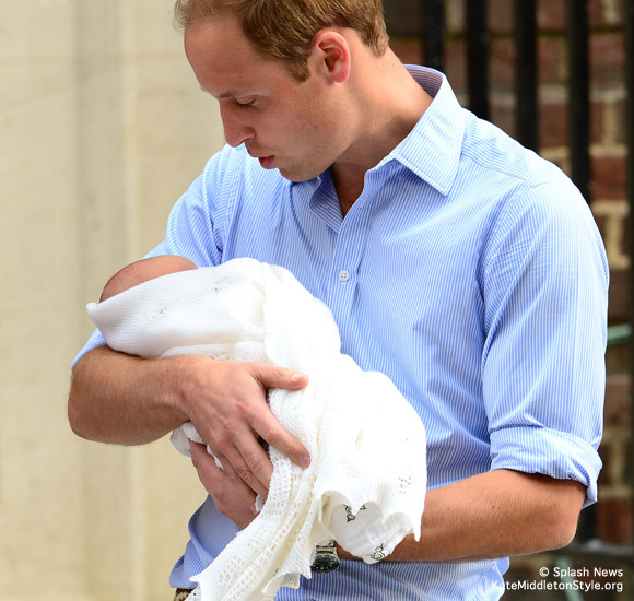 Daddy William holds his new baby boy