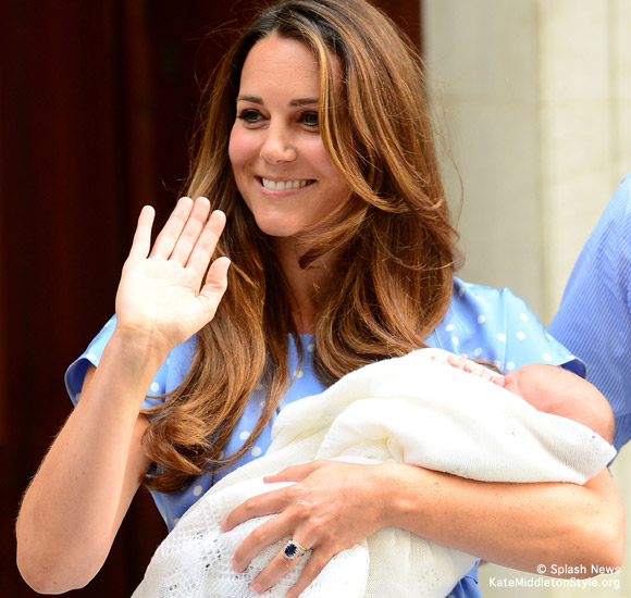 Kate Middleton holds her baby boy, the new prince of Cambridge
