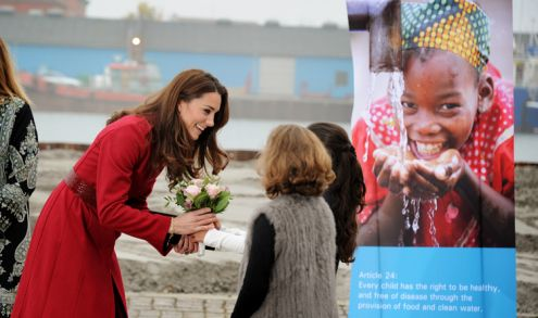 Kate is given a bunch of flowers at the beginning of the Unicef tour