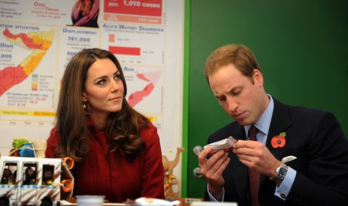 William inspects some of the food as Kate listens on...