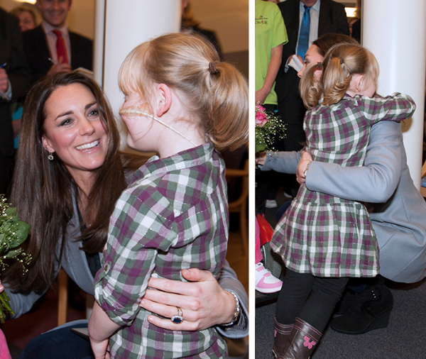 Duchess Kate hugs a little girl at the hospice