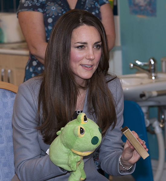 Duchess Kate plays with a frog puppet © shootingstarchase.org.uk