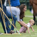 Kate chases after Prince George at the polo today