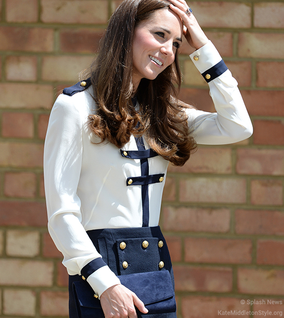 Kate carrying her blue 'Muse' clutch bag