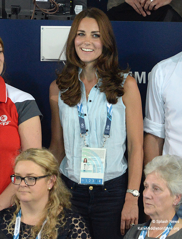Kate in the sleeveless blue and white stripe blouse