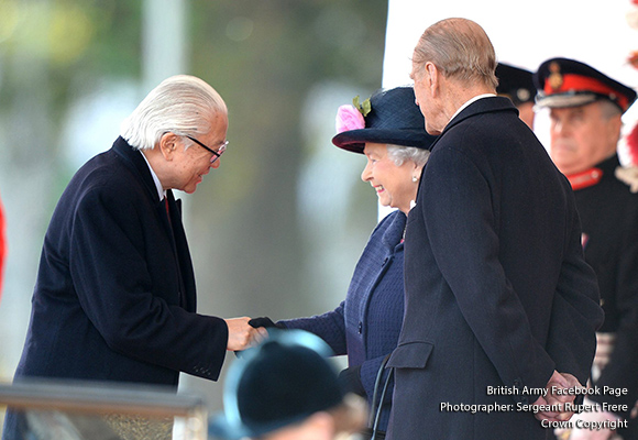 The Queen greeting President Tan