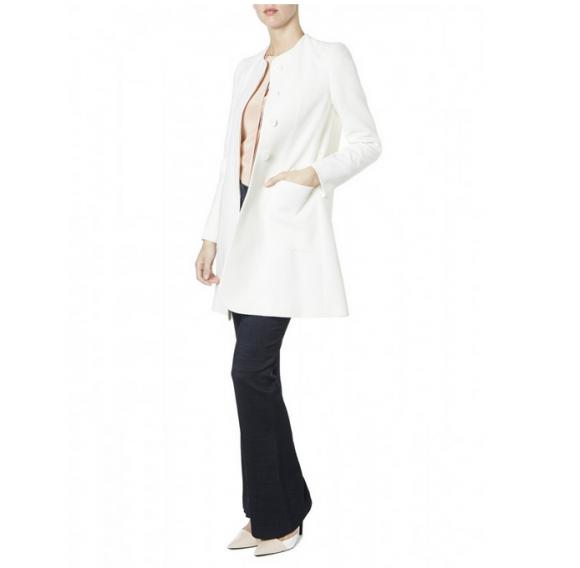 Model wearing the Goat Redgrave Coat in Cream/White