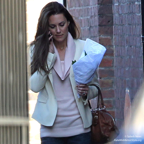 Kate speaking on her phone shortly before her wedding in April 2011.  She wore a pink cowl neck sweater.