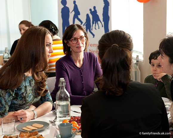 Kate chats with families and volunteers during her visit