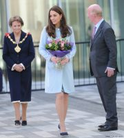 Kate Middleton wearing her blue Seraphine Maternity coat while pregnant with Princess Charlotte