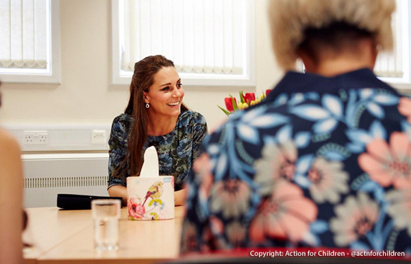 Kate attends a round-table discussion at Action for Children