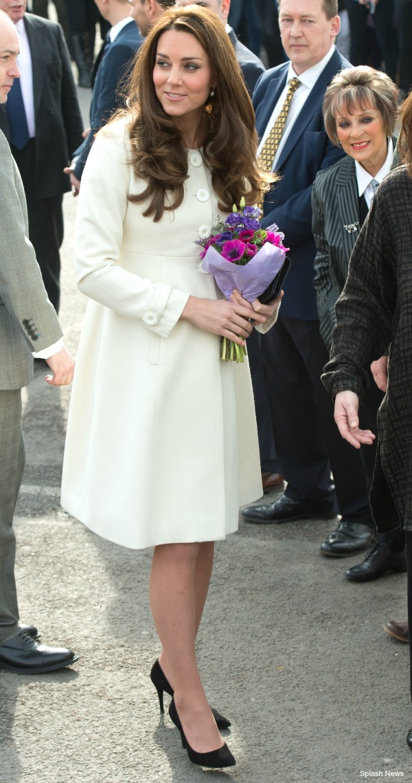 The Duchess of Cambridge wore a JoJo Maman Bebe maternity coat for her visit to Downton Abbey today