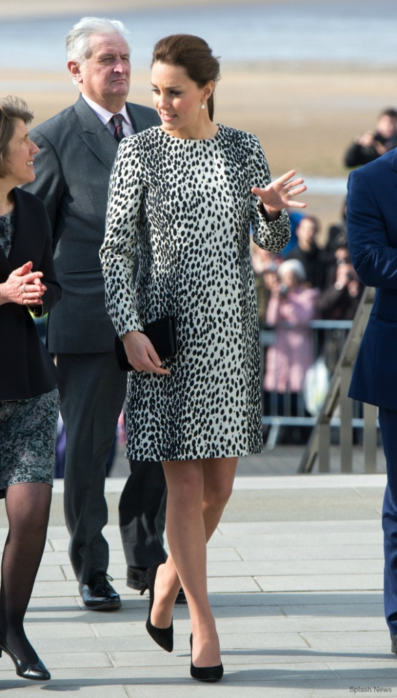 Kate wears a black and white spotty Dalmatian print coat in Margate today