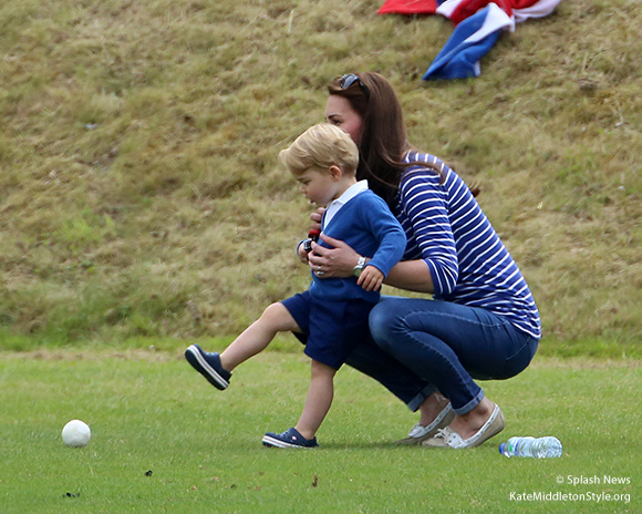 Prince George kicks a ball
