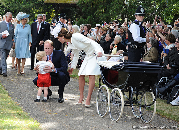 Royal fans and well-wishers queue to get a glimpse of Princess Charlotte and the Cambridge family at the christening today