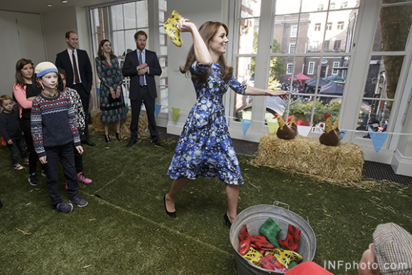Kate takes part in the welly wanging competition