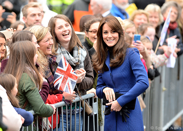 Duchess of Cambridge / Kate Middleton visits Dundee carrying the Stuart Wetizman Muse Clutch Bag in black suede