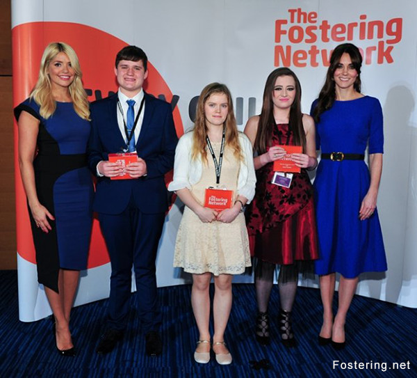 Kate hands the winners the Fostering Achievement Award