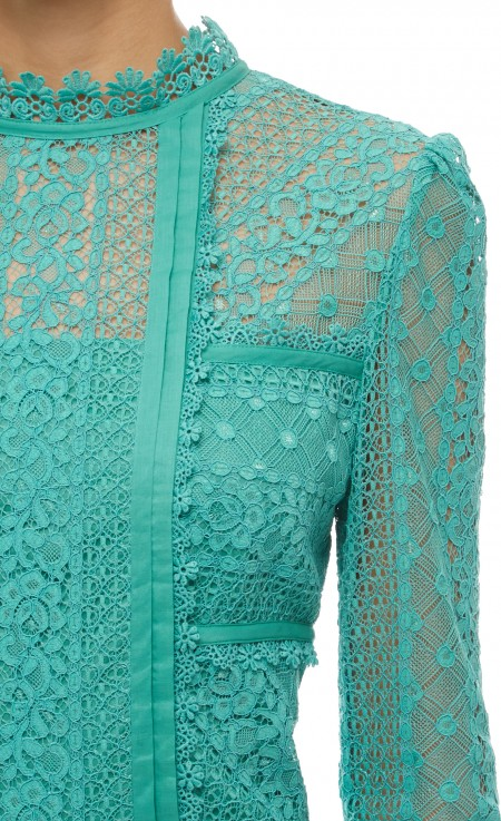 The teal/green lace detailing on the Desdemona dress