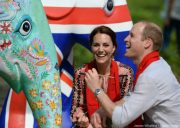 Kate Middleton paint an elephant in India wearing her pink and black embroidered smock dress
