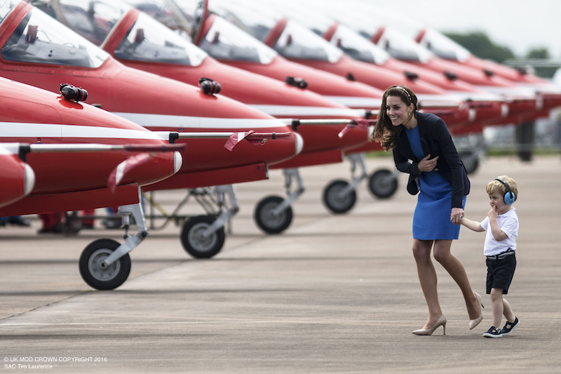 Kate Middleton wearing the blue Smythe Duchess Blazer at the Air Tattoo with Prince George