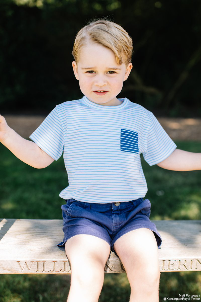 Prince George sat on the swing featuring his parents' names