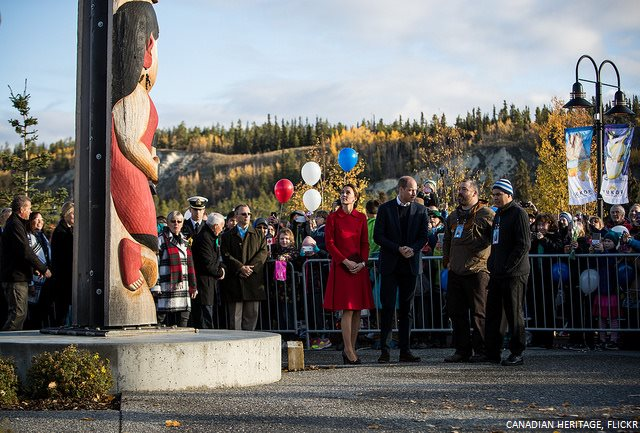 The couple view the Totem pole