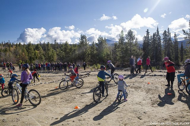 William and Kate meet with young bikers at Montana Mountain in Yukon