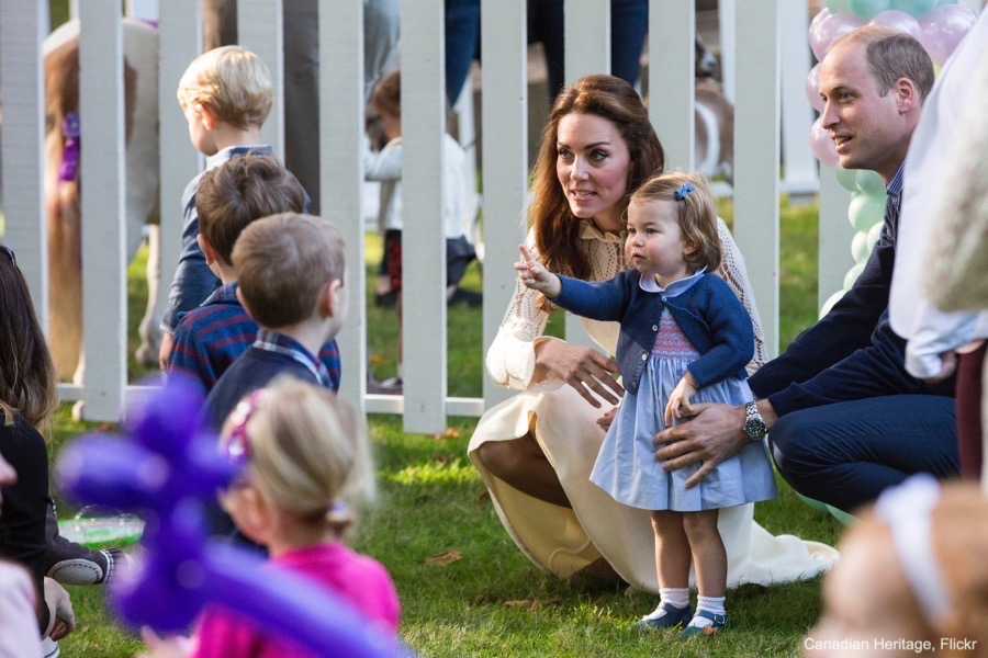 George and Charlotte play with other children at the party in Canada