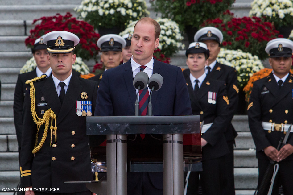 William delivering a speech in Canada