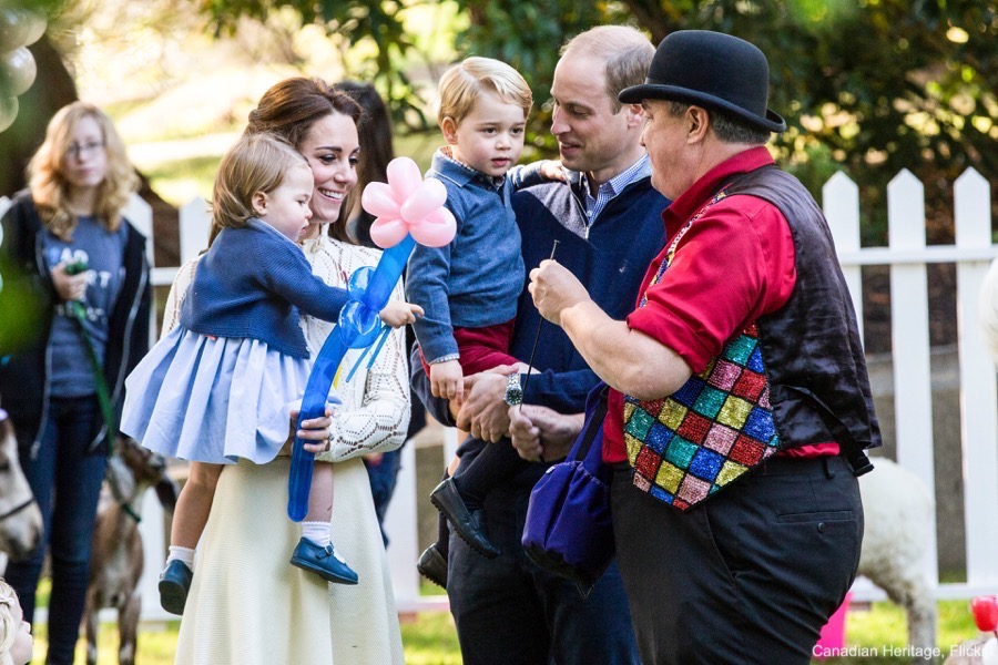 George and Charlotte receive balloon animals